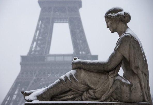 Snow blankets a statue at Trocadero near the Eiffel Tower in Paris on March 12.Credit Ian Langsdon/European Pressphoto Agency