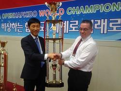 Steve receiving trophy for best team