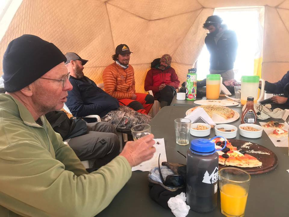 Eating dinner at 14000 feet with some of our new climbing buddies we met on the summit.