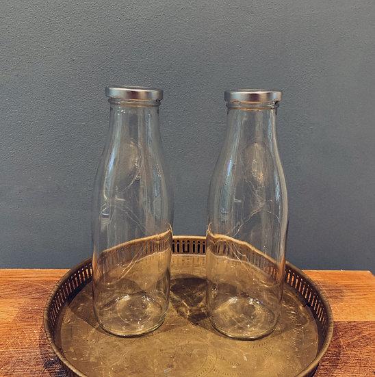 Two Classic Glass Milk Bottles