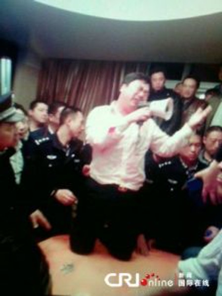 A local party official begs for mercy after citizens crash his illegal banquet