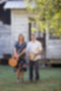 Frak & Allie portrait guitar and banjo