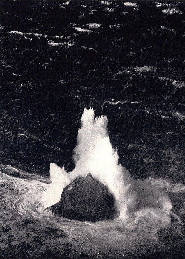 A 1943 photograph of a large wave breaking over the islet of Rockall, in the North Atlantic Ocean. Rockall's peak is about 17 m (56 ft) above sea-level, and the height of the spray has been estimated at about 52 m (170 ft).