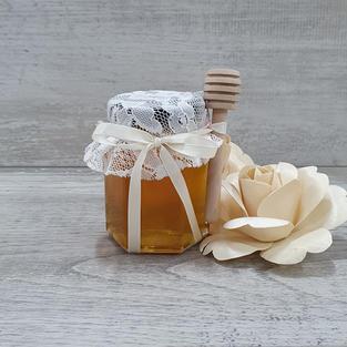 Vintage honey jar with honey dipper.