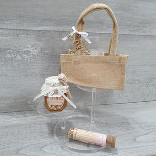 Sweet as can be set offering Australian made honey jar, tube of chamomile tea buds and bonbonniere complete in a hessian bag with wooden guest name attached.