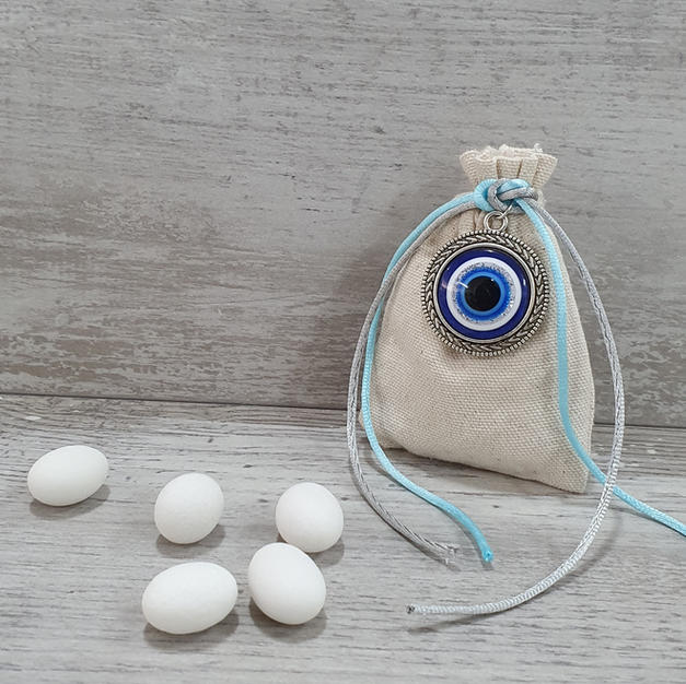 Neutral pouch with evil eye.