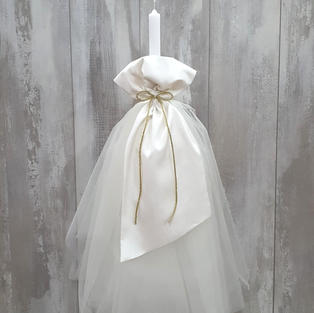 Elegant candle with ivory tulle skirt and silk overlay.
