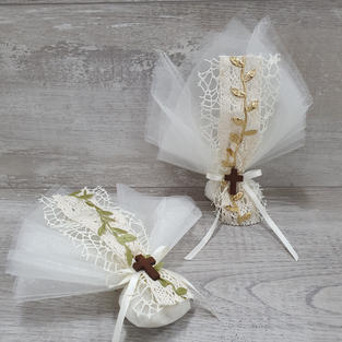 Doubled layered organza bonbonniere with vintage gold or green lace vine and wooden cross.