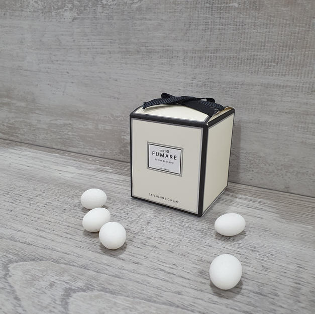 Scented candle in jar with lid.