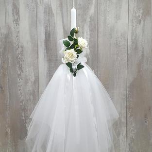 White tulle skirt with flower arrangement decoration.
