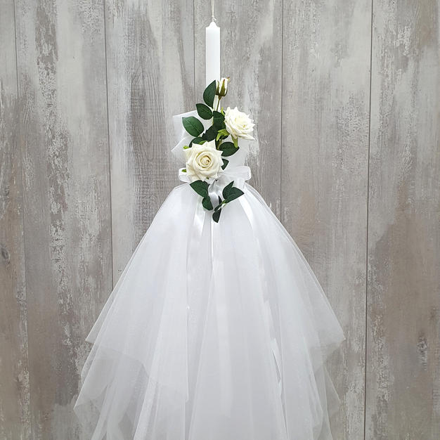 White tulle skirt with flower arrangement decoration.