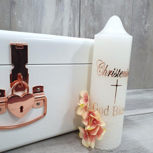Rose gold floral candle and white/rose gold storage trunk.