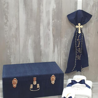 Corduroy box and candle with Elite Deluxe contents.