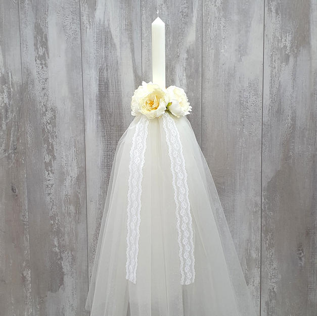 Round candle in ivory tulle and lace with floral arrangement. Wedding candles come as a pair.
