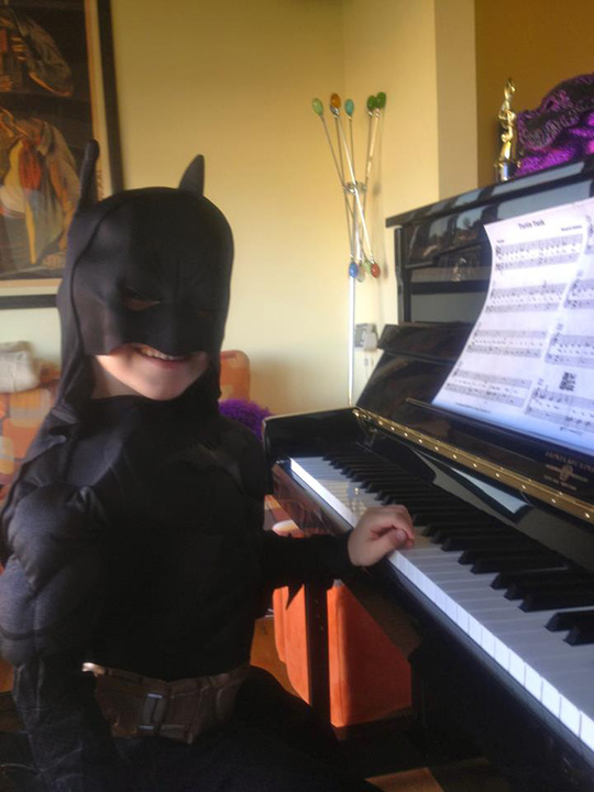 Teaching batman piano