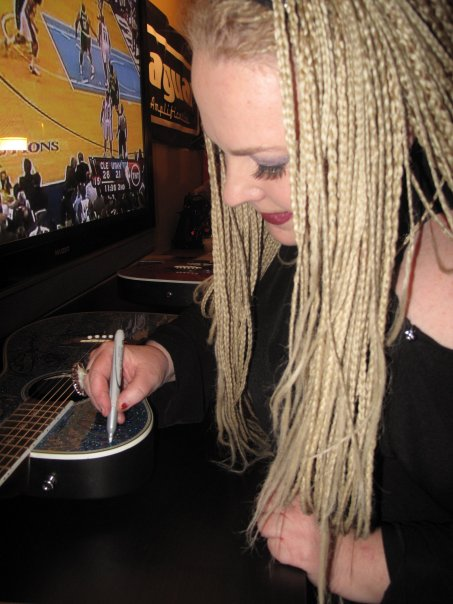 signing a guitar at Namm