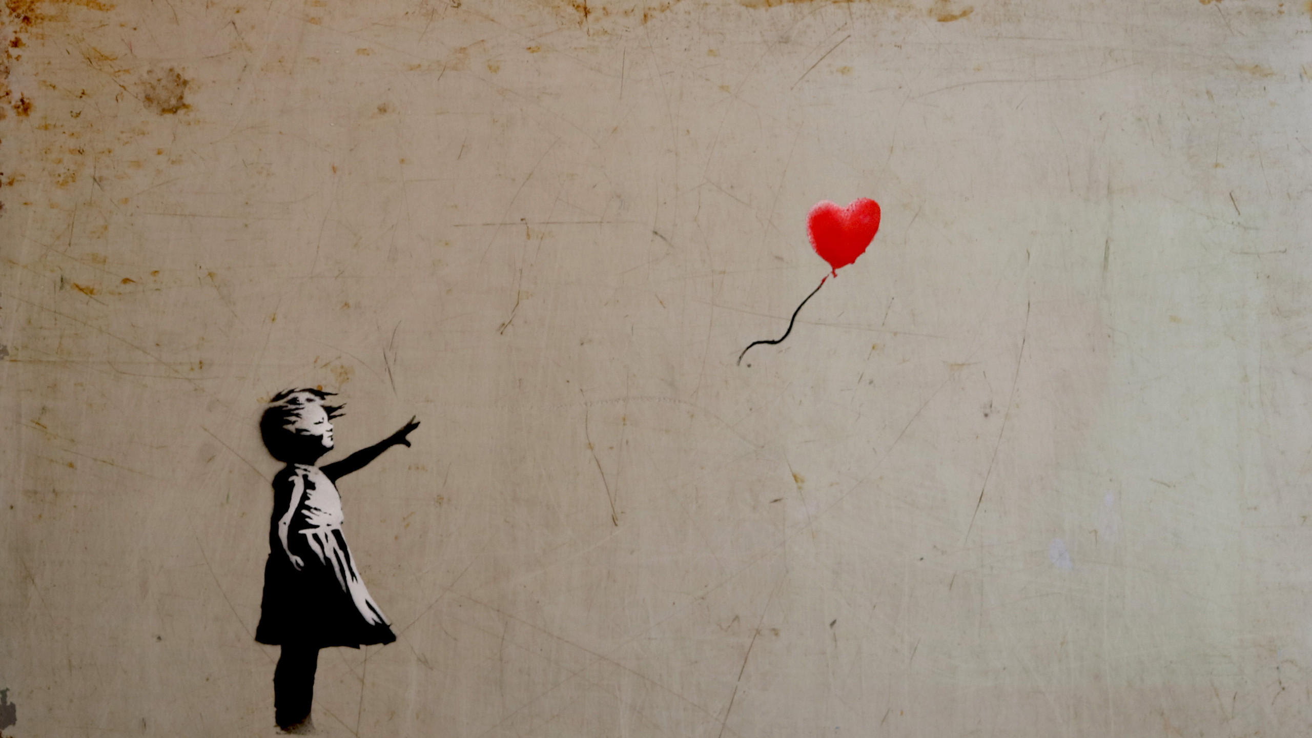The image evokes the idea that hope is essential, as it gives the ppl motivation to continue on in life despite seemingly dreary circumstances. Banksy is cleverly able to use the squalid surroundings in which the work is placed to portray bleakness during difficult times and the possibility of happiness or satisfaction despite adversity. Love, symbolized by the balloon, is a fundamental human need and must be cherished.