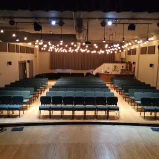 Auditorium 135 chairs with tables at the