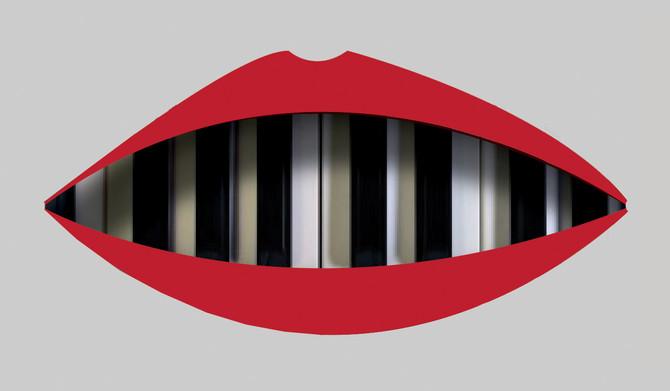 De witte tanden van een piano