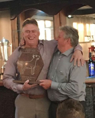 Bennie and Dave Thompson celebrating the Stud Dog Trophy: Ch Reithsons Devils Dynamo of Shodan