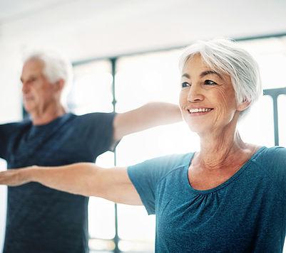 Elderly Couple Practising Yoga