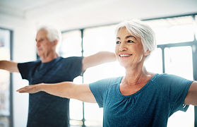 Elderly Couple Practicing Yoga