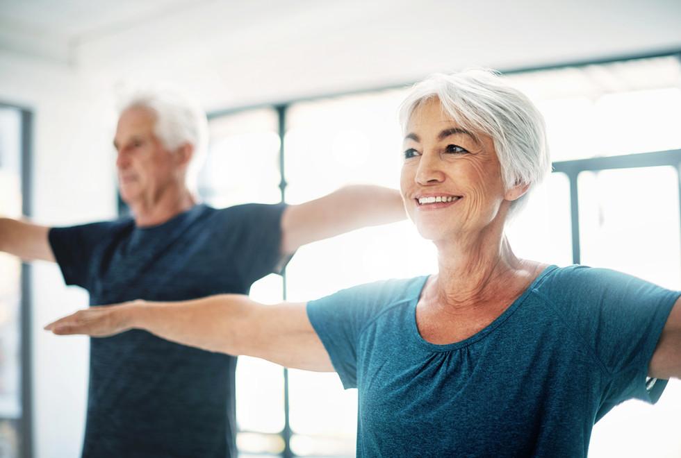 Elderly Couple Practising Yoga | Knoxville Medical Center