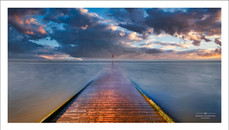 Long exposure shot of the high tide covering the old wooden jetty. Lytham, Lancashire, UK.