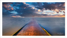 A long exposure of the high  tide covering the wooden jetty in Lytham, Lancashire, UK