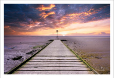 Sunset over an old wooden jetty in Lytham, Lancashire