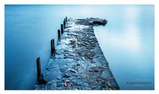 A stone jetty stretches o Coniston