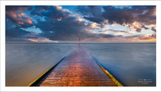 Long exposure of the high tide as it swamps the wooden jetty at Lytham, Lancashire, UK