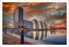 Sunset over a dock and the NV Buildings in Salford Quays
