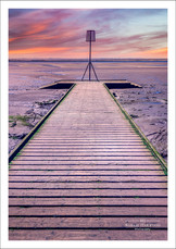 The wooden jetty in Lytham, Lancashire at sunset