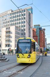 Yellow Metrolink tram in Manchester