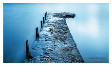 A stone jetty stretches out on to Coniston Water