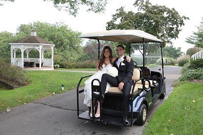 Melanie and Kyle Golf Cart.jpg