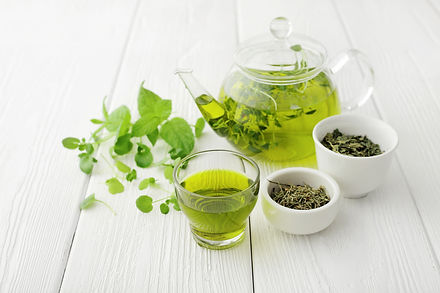 healthy green tea cup with tea leaves .j