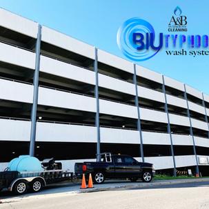 Fargo parking ramp after powerwashing with blue typhoon wash system