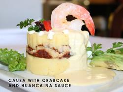 CAUSA WITH CRABCAKE AND HUANCAINA SAUCE-