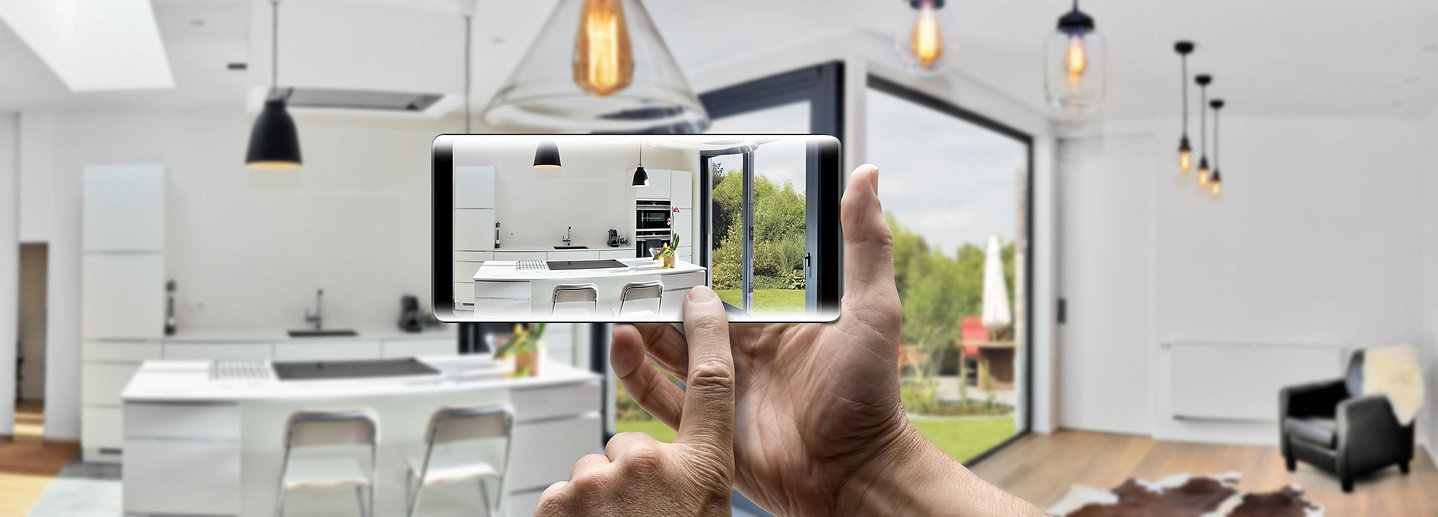 2 hands holding iphone in kitchen  (2).j