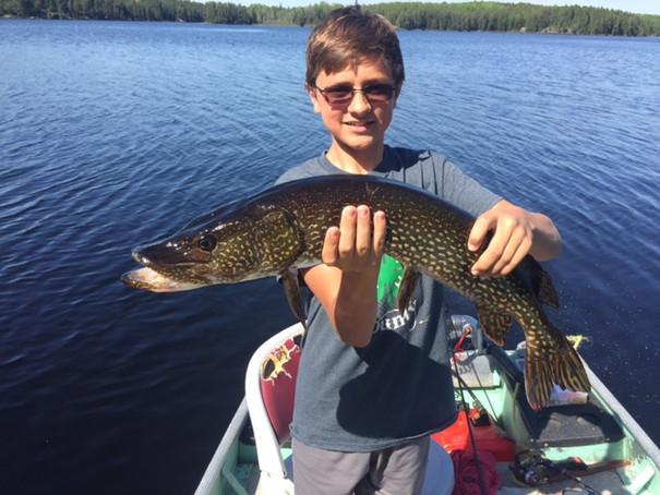 Kids fishing pike