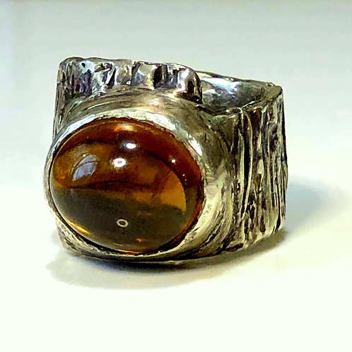 Statement ring with large tourmaline on highly textured band.