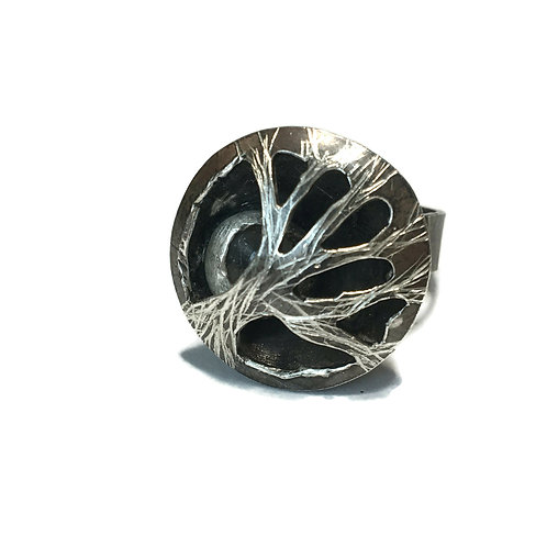 Statement ring with moon (moonstone) seen through branches