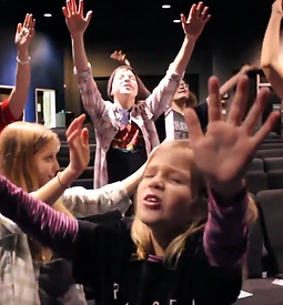 Kids praying in bowls video.png
