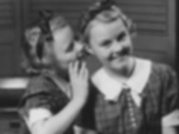 girl-sharing-secret-with-sister.jpg