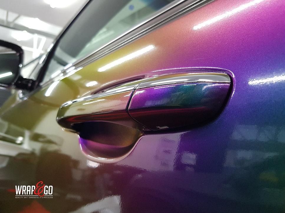 Kia Sportage Carwrap Avery ColorFlow door WrapAndGo handgreep