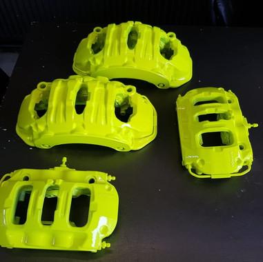 Remklauwen spuiten fluor geel porsche