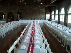 Wide view of white table with red ru