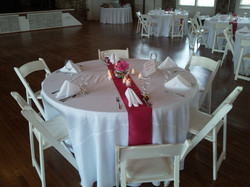White round table with red runner